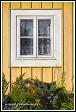 Okno historického dřevěného domu na ulici Karaimų, Trakai, Památka UNESCO, Národní park Trakų istorinis, Litva